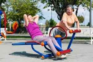 elders exercising in a senior playground