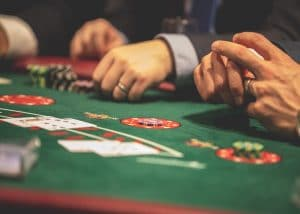 people playing poker in a casino