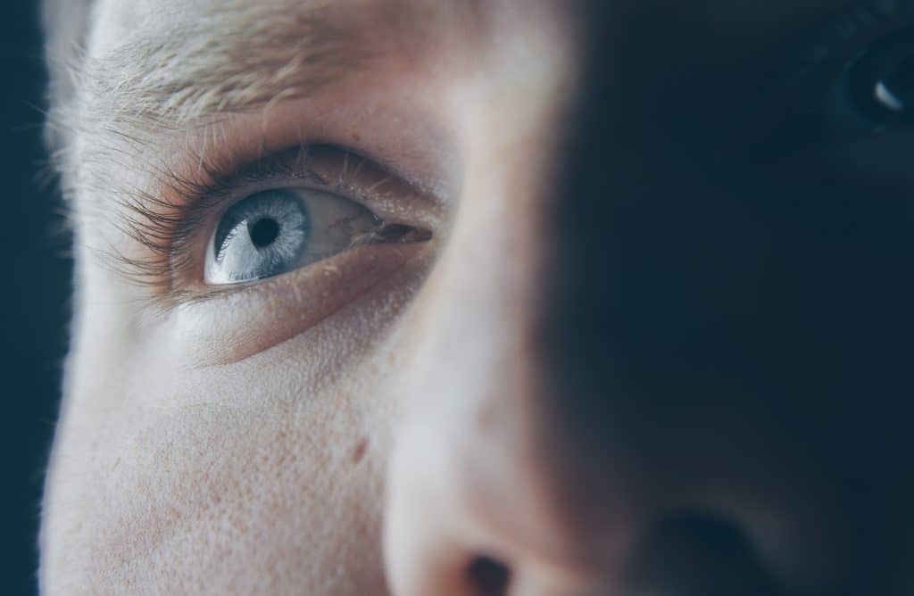 man with blue eyes staring into the distance