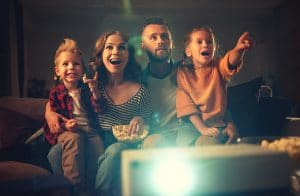 family watching a movie together at home