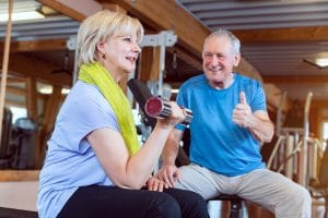 elderly couple doing bicep workout