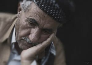 sad old man pondering